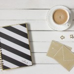 coffee notebook and envelopes